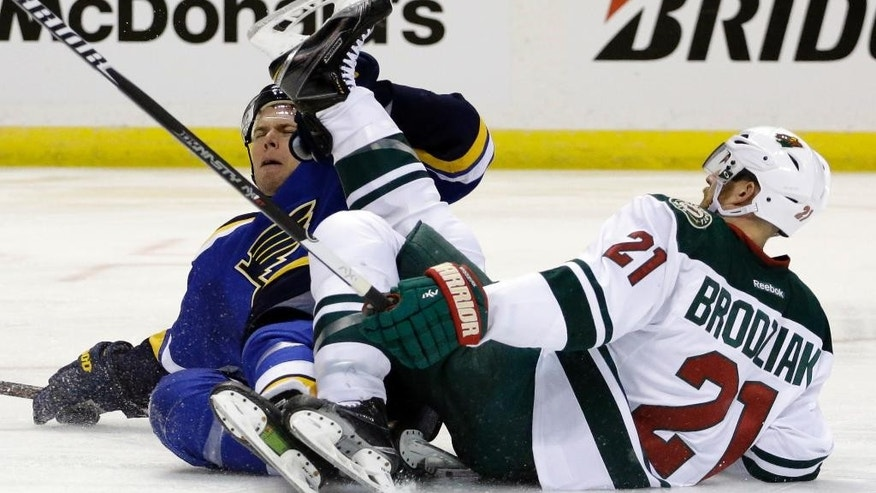 St. Louis Blues' Paul Stastny, left, and Minnesota Wild's Kyle Brodziak get tangled up during the second period in Game 2 of an NHL hockey first-round playoff series, Saturday, April 18, 2015, in St. Louis. (AP Photo/Jeff Roberson)
