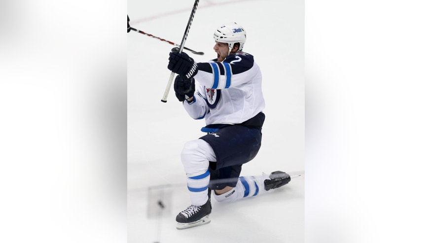 Winnipeg Jets defenseman Adam Pardy celebrates after scoring against the Anaheim Ducks during the second period of Game 2 of a first-round NHL hockey playoff series in Anaheim, Calif., Saturday, April 18, 2015. (AP Photo/Chris Carlson)