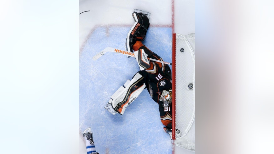 Anaheim Ducks goalie Frederik Andersen fails to block a goal by Winnipeg Jets defenseman Adam Pardy during the second period of Game 2 of a first-round NHL hockey playoff series in Anaheim, Calif., Saturday, April 18, 2015. (AP Photo/Chris Carlson)