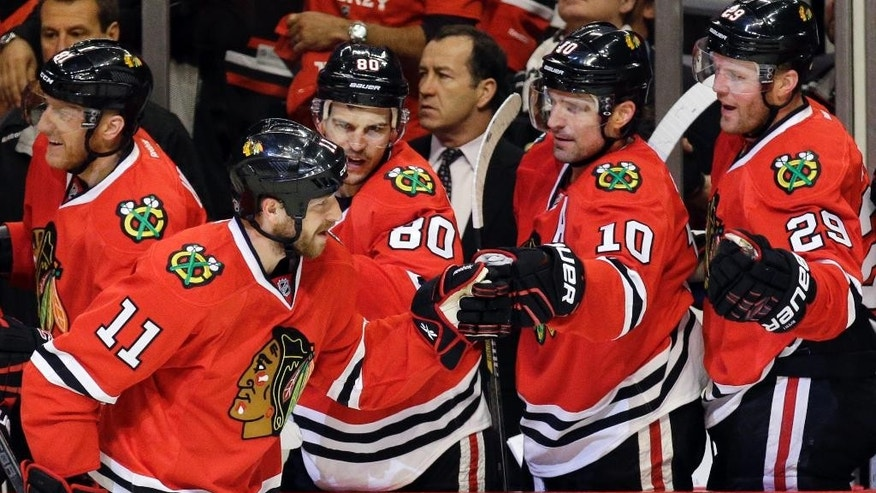 Chicago Blackhawks center Andrew Desjardins (11) celebrates with teammates after scoring his goal during the first period in Game 3 of an NHL Western Conference hockey playoff series against the Nashville Predators Sunday, April 19, 2015, in Chicago. (AP Photo/Nam Y. Huh)
