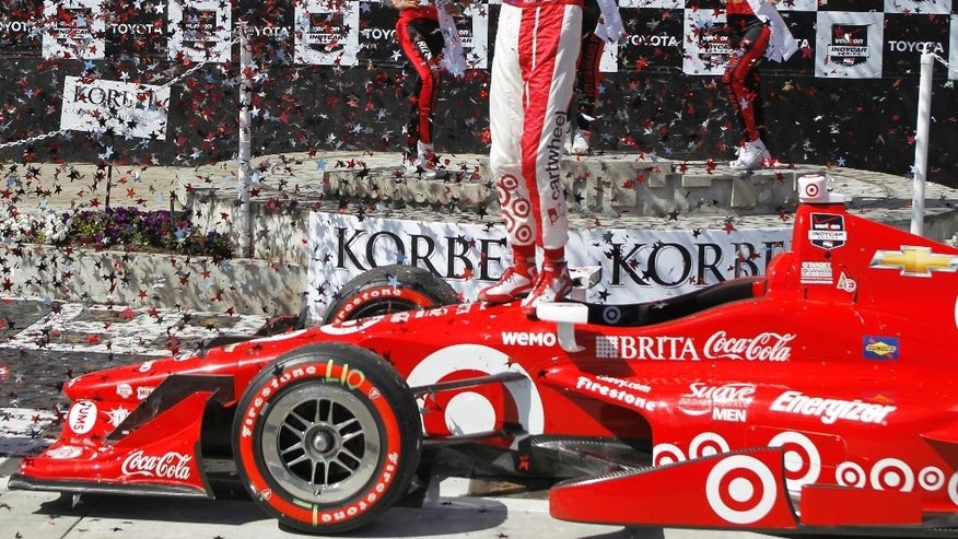 Scott Dixon, of New Zealand, reacts in the Winner's Circle after winning the IndyCar Toyota Grand Prix of Long Beach auto race on Sunday, April 19, 2015, in Long Beach, Calif. (AP Photo/Alex Gallardo)