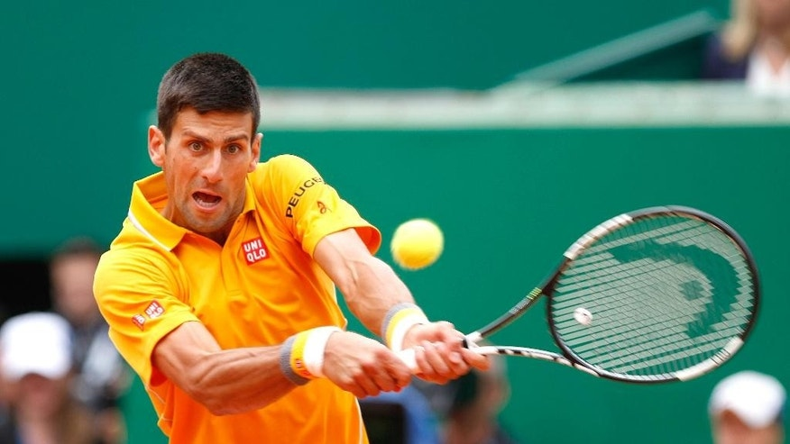 Novak Djokovic of Serbia  plays a return to Tomas Berdych of Czech Republic during their final match of the Monte Carlo Tennis Masters tournament in Monaco, Sunday, April 19, 2015. (AP Photo/Claude Paris)