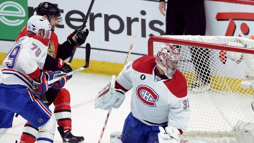 Montreal Canadiens goalie Carey Price (31) and defenceman Andrei Markov (79) react after Ottawa Senators forward Clarke MacArthur (16) scores during the first period of game 3 of first round Stanley Cup NHL playoff hockey action in Ottawa, Ontario, on Sunday, April 19, 2015.  (Sean Kilpatrick/The Canadian Press via AP)   MANDATORY CREDIT