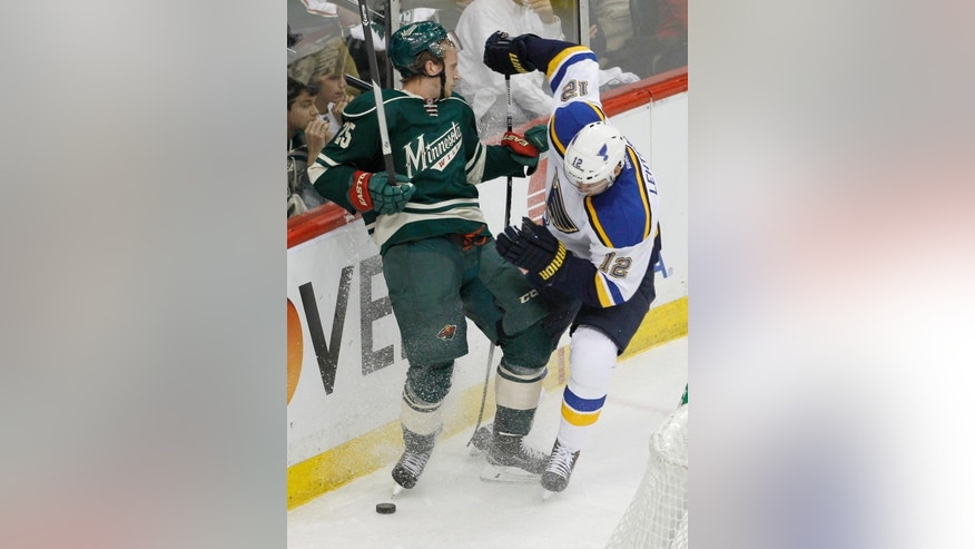 Minnesota Wild defenseman Jonas Brodin (25) and St. Louis Blues center Jori Lehtera (12), of Finland, battle for the puck during the first period of Game 3 of an NHL hockey first-round playoff series game in St. Paul, Minn., Monday, April 20, 2015. (AP Photo/Ann Heisenfelt)