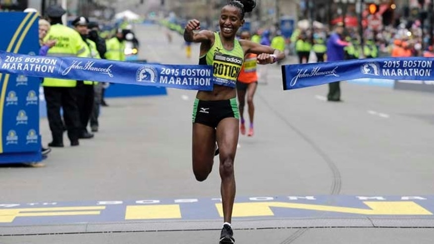 April 20, 2015: Caroline Rotich, of Kenya, breaks the tape to win the women's division of the Boston Marathon in Boston.
