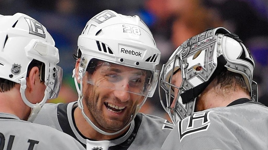 FILE - In this April 11, 2015, file photo, Los Angeles Kings center Jarret Stoll, center, congratulates goalie Jonathan Quick, right, as center Tyler Toffoli watches after an NHL hockey game against the San Jose Sharks in Los Angeles. Stoll was released on $5,000 bond from the Clark County Detention Center in Las Vegas on Friday night, April 17, 2015, KSNV-TV of Las Vegas reported.  He is accused of possession of controlled substances, including cocaine and Ecstasy. (AP Photo/Mark J. Terrill, File0