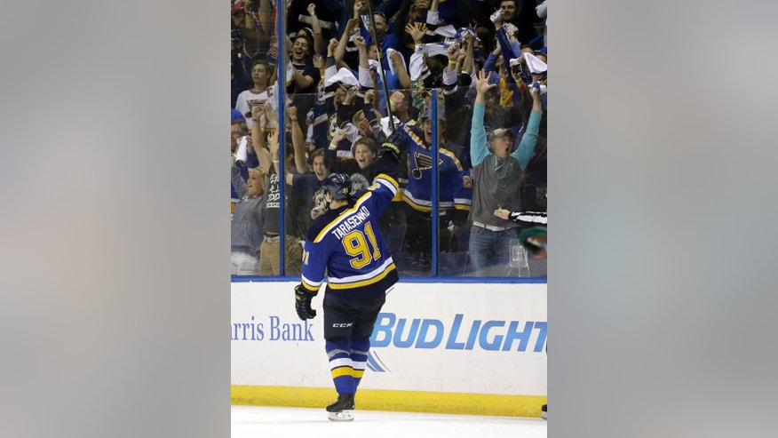 St. Louis Blues' Vladimir Tarasenko, of Russia, acknowledges the crowd after scoring his third goal of the game during the third period in Game 2 of an NHL hockey first-round playoff series against the Minnesota Wild, Saturday, April 18, 2015, in St. Louis. The Blues won 4-1 to tie the series 1-1. (AP Photo/Jeff Roberson)