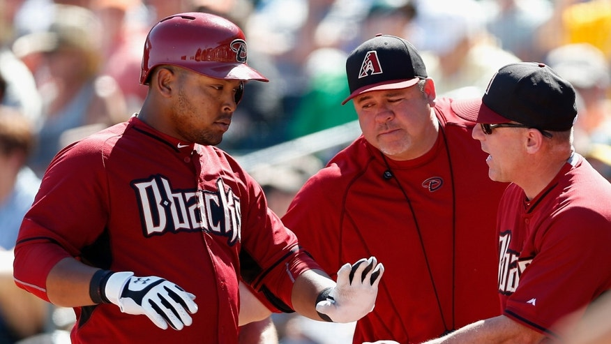 MESA, AZ - MARCH 10:  Yasmany Tomas #24 (L) of the Arizona Diamondbacks high fives manager Chip Hale #3 (R) after Tomas hit a solo home-run against the Oakland Athletics during the second inning of the spring training game at HoHoKam Stadium on March 10, 2015 in Mesa, Arizona.  (Photo by Christian Petersen/Getty Images)