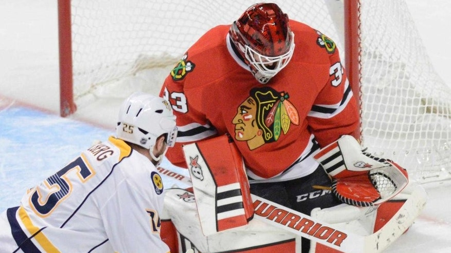 Chicago Blackhawks goalie Scott Darling stops a shot by Nashville Predators left wing Viktor Stalberg late in the third period in Game 4 of an NHL Western Conference hockey playoff series against the Nashville Predators on Tuesday, April 21, 2015, in Chicago. (Daily Herald,  John Starks via AP)