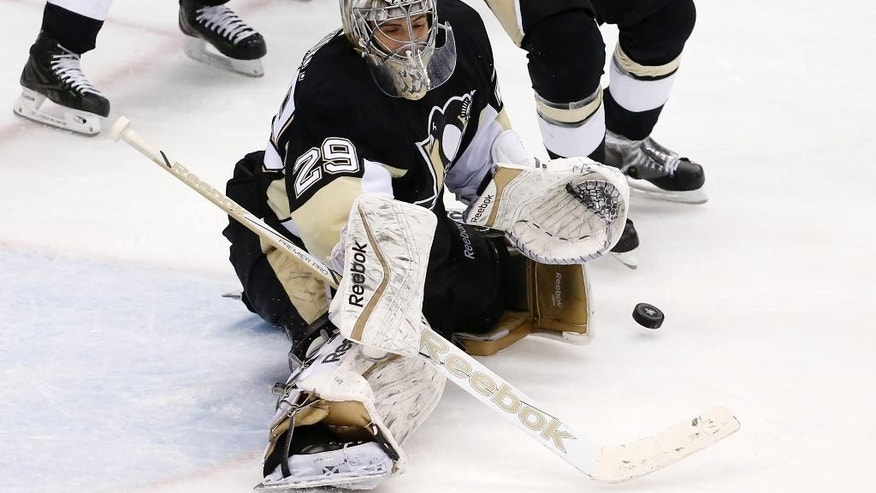 Pittsburgh Penguins goalie Marc-Andre Fleury (29) stops a shot during the third period of a first-round NHL playoff hockey game against the New York Rangers in Pittsburgh on Wednesday, April 22, 2015. (AP Photo/Gene J. Puskar)