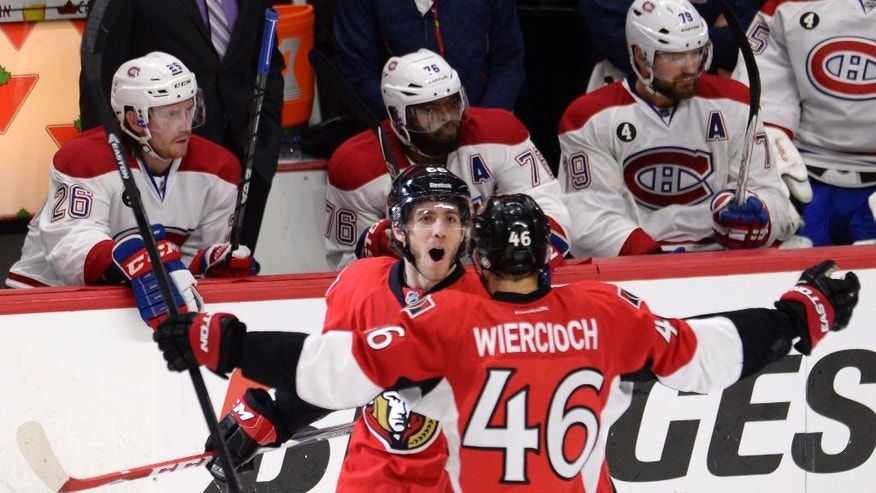 Ottawa Senators' Mike Hoffman (68) celebrates scoring on the Montreal Canadiens with teammate Patrick Wiercioch during the third period in Game 4 of an NHL hockey first-round playoff series, Wednesday, April 22, 2015 in Ottawa, Ontario. (Adrian Wyld/The Canadian Press via AP)  MANDATORY CREDIT