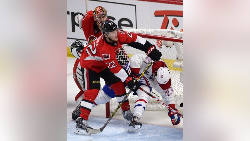 Montreal Canadiens' Alex Galchenyuk (27) is hit into the net by Ottawa Senators' Erik Condra as Senators goalie Craig Anderson looks on during the second period in Game 4 of an NHL hockey first-round playoff series, Wednesday, April 22, 2015 in Ottawa, Ontario. (Adrian Wyld/The Canadian Press via AP)  MANDATORY CREDIT