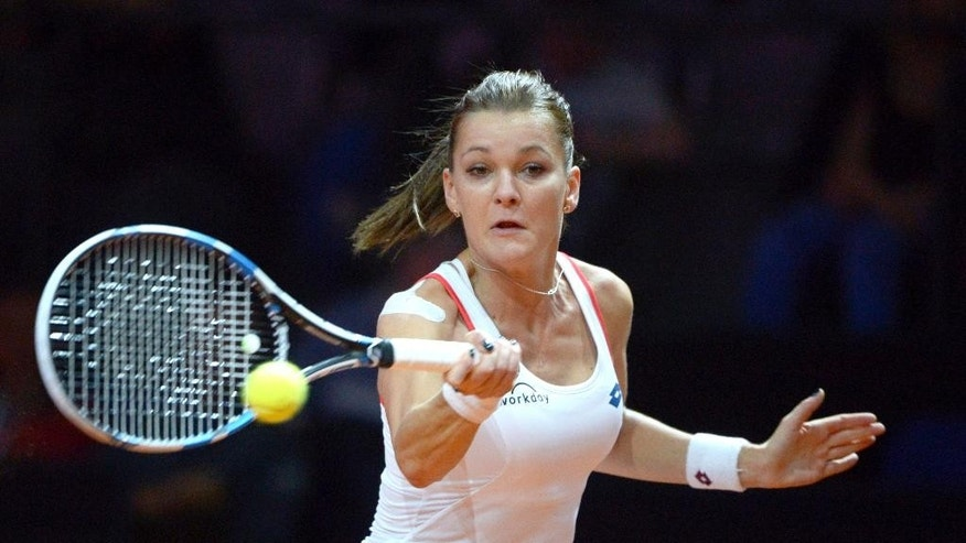 Agnieszka Radwanska of Poland returns the ball to Sara Errani of Italy in the first round of the Porsche Grand Prix tennis tournament in Stuttgart, Germany, Wednesday, April 22, 2015. (Marijan Murat/dpa via AP)
