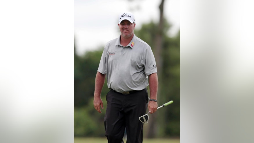 Boo Weekley reacts after missing a putt on the 11th hole during the first round of the Zurich Classic PGA golf tournament, Thursday, April 23, 2015, in Avondale, La. (AP Photo/Butch Dill)