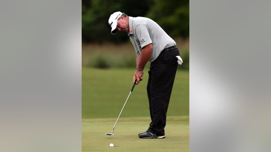 Boo Weekley sinks a putt on the 13th hole during the first round of the Zurich Classic PGA golf tournament, Thursday, April 23, 2015, in Avondale, La. (AP Photo/Butch Dill)