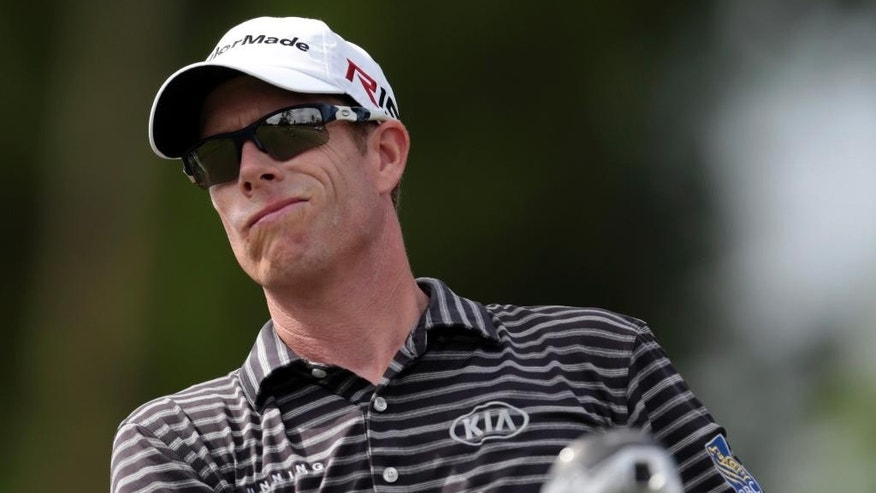 David Hearn, of Canada, reacts to his tee shot on the 15th hole during the first round of the Zurich Classic PGA golf tournament, Thursday, April 23, 2015, in Avondale, La. (AP Photo/Butch Dill)