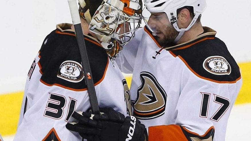 Anaheim Ducks goaltender Frederik Andersen (31) and teammate Ryan Kesler congratulate each other after Game 4 against the Winnipeg Jets in a first-round NHL hockey playoff series, Wednesday, April 22, 2015, in Winnipeg, Manitoba. Anaheim won 5-2 and swept the series. (John Woods/The Canadian Press via AP)