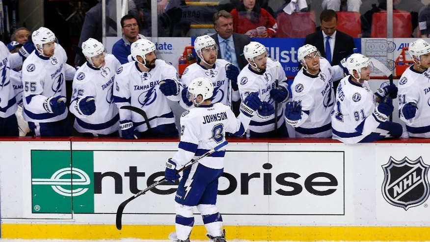 Tampa Bay Lightning center Tyler Johnson (9) celebrates his goal against the Detroit Red Wings during the third period of Game 4 of a first-round NHL Stanley Cup hockey playoff series Thursday, April 23, 2015, in Detroit. (AP Photo/Paul Sancya)