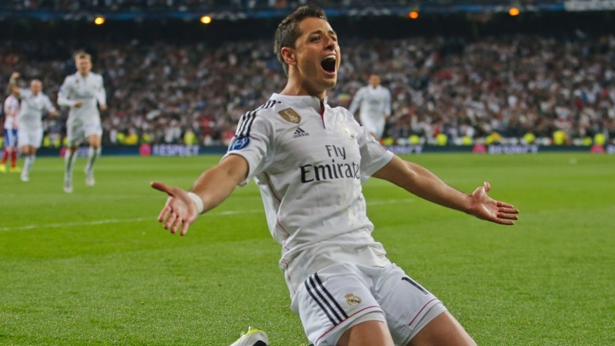 Real Madrid's Chicharito celebrates scoring his side's first goal during the second leg quarterfinal Champions League soccer match between Real Madrid and Atletico Madrid at Santiago Bernabeu stadium in Madrid, Spain, Wednesday April 22, 2015. Real won the match with a 1-0 score and advances to the semifinal. (AP Photo/Paul White)