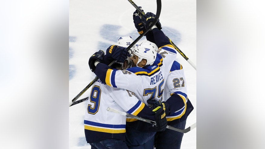 St. Louis Blues right wing Ryan Reaves (75) celebrates with teammates after his goal on Minnesota Wild goalie Devan Dubnyk during the first period of Game 4 of an NHL hockey first-round playoff series game in St. Paul, Minn., Wednesday, April 22, 2015. (AP Photo/Ann Heisenfelt)