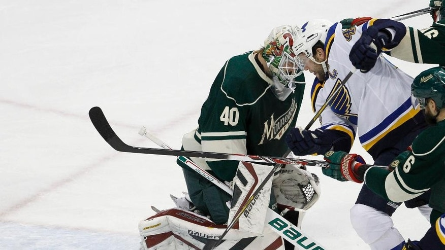 St. Louis Blues center David Backes, right, scores on Minnesota Wild goalie Devan Dubnyk (40) during the first period of Game 4 of an NHL hockey first-round playoff series game in St. Paul, Minn., Wednesday, April 22, 2015. (AP Photo/Ann Heisenfelt)