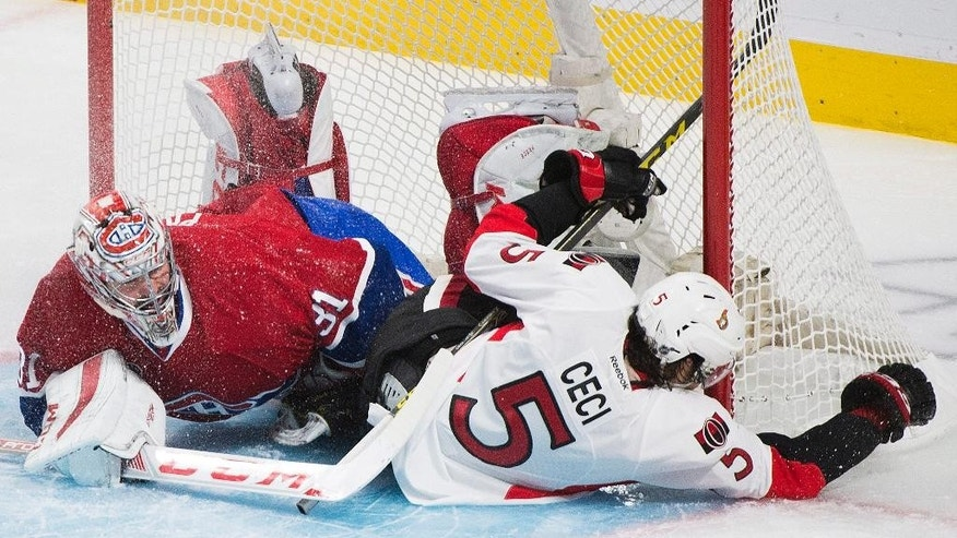 Ottawa Senators' Cody Ceci collides with Montreal Canadiens goaltender Carey Price during the second period of Game 5 of a first-round NHL hockey playoff series, Friday, April 24, 2015, in Montreal. (Graham Hughes/The Canadian Press via AP)