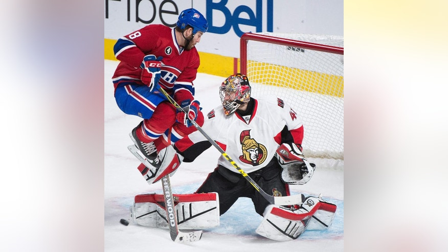 Ottawa Senators goaltender Craig Anderson makes as a save against the Montreal Canadiens as Canadiens' Brandon Prust looks for the rebound during the third period of Game 5 of a first-round NHL hockey playoff series, Friday, April 24, 2015, in Montreal. (Graham Hughes/The Canadian Press via AP)