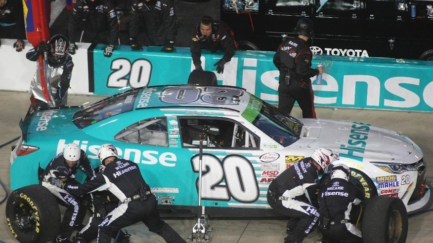 Denny Hamlin makes a pit stop during the Xfinity series NASCAR auto race at Richmond International Raceway in Richmond, Va., Friday, April 24, 2015. (AP Photo/Jason Hirschfeld)
