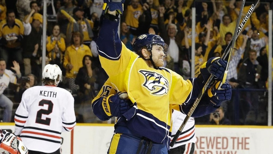 Nashville Predators center Colin Wilson, right, celebrates after scoring a goal against the Chicago Blackhawks during the third period of Game 5 of an NHL hockey first-round playoff series Thursday, April 23, 2015, in Nashville, Tenn. (AP Photo/Mark Humphrey)