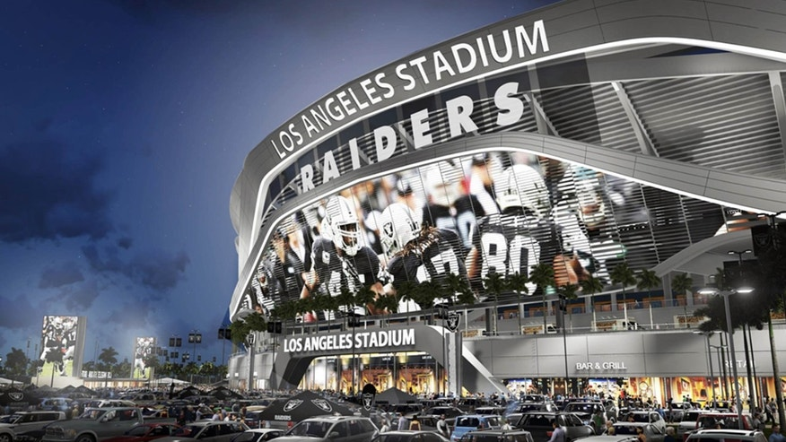 April 23, 2015: This artists's rending provided by Carson2gether shows the exterior of revised plans for a proposed stadium that would house both the Chargers and the Raiders NFL football teams, shown here in Raiders home game configuration, in Carson, Calif.