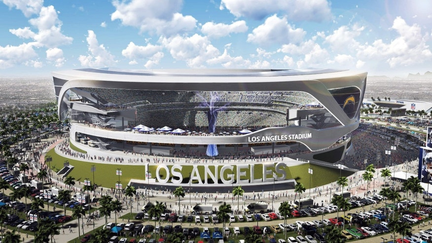 April 23, 2015: This artist's rendering provided by Carson2gether shows the exterior of a newly revised plan for a proposed stadium that would house both the Chargers and the Raiders NFL football teams, here in Chargers' home game configuration, in Carson, Calif.