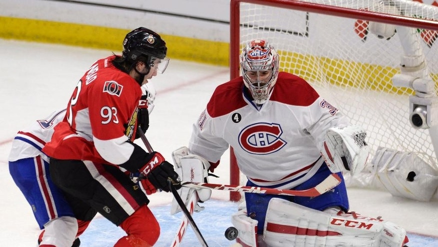 Montreal Canadiens goalie Carey Price stops Ottawa Senators' Mika Zibanejad (93) as Canadiens' David Desharnais defends during the third period in Game 4 of an NHL hockey first-round playoff series, Wednesday, April 22, 2015 in Ottawa, Ontario. (Adrian Wyld/The Canadian Press via AP)  MANDATORY CREDIT