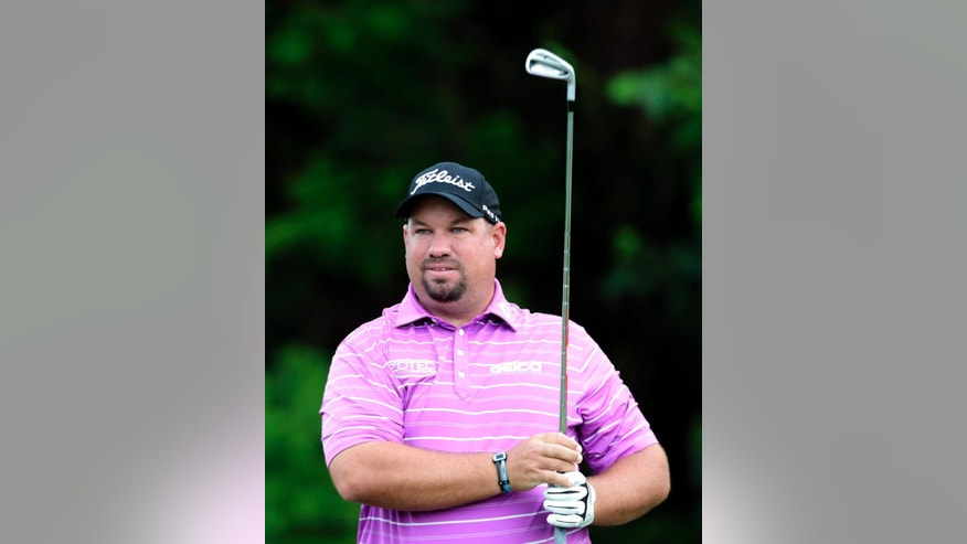 Brendon de Jonge, of Zimbabwe, watches his tee shot on the third hole during the second round of the Zurich Classic PGA golf tournament, Friday, April 24, 2015, in Avondale, La. (AP Photo/Butch Dill)