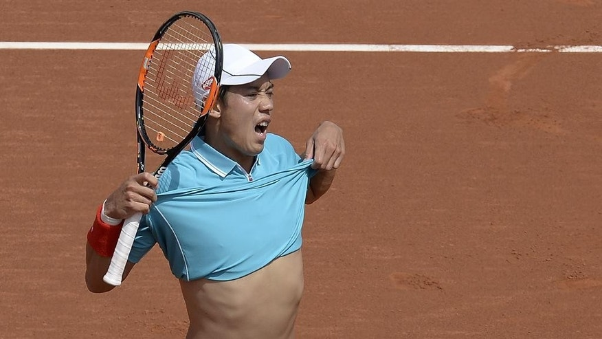 Kei Nishikori of Japan reacts during his match against Roberto Bautista of Spain, during the Barcelona open tennis tournament in Barcelona, Spain, Friday, April 24, 2015. (AP Photo/Manu Fernandez)