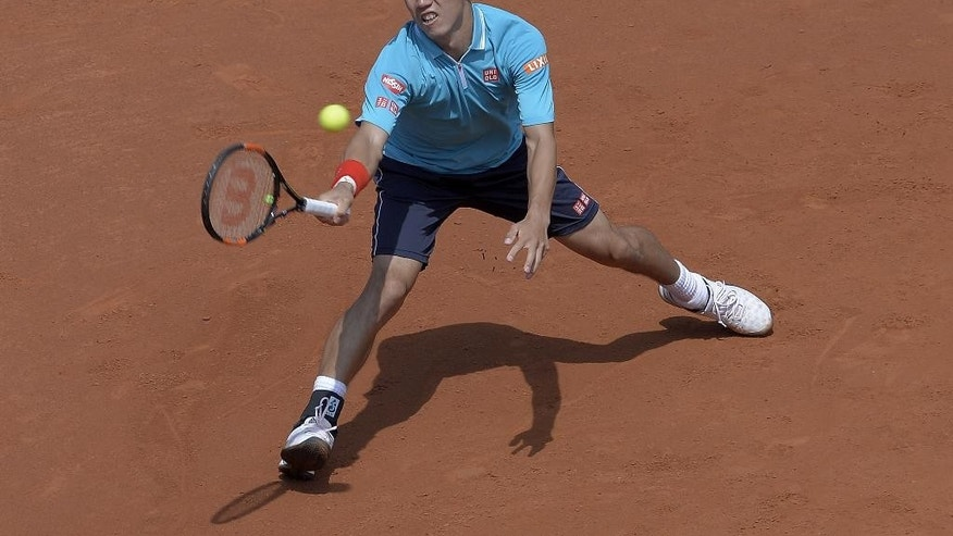 Kei Nishikori of Japan plays a return to Roberto Bautista of Spain, during the Barcelona open tennis tournament in Barcelona, Spain, Friday, April 24, 2015. (AP Photo/Manu Fernandez)