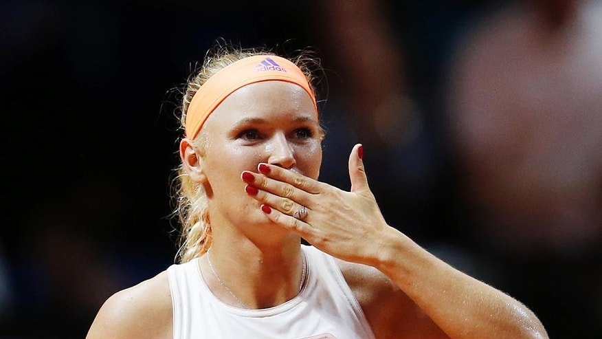 Denmark's Caroline Wozniacki blows a kiss after beating Romania's Simona Halep in their semifinal match at the Porsche Grand Prix tennis tournament in Stuttgart, Germany, Saturday, April 25, 2015. (AP Photo/Michael Probst)