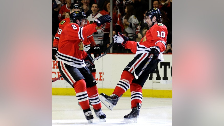 Chicago Blackhawks left wing Patrick Sharp, right, celebrates with defenseman Duncan Keith after scoring a goal during the first period in Game 6 of an NHL Western Conference hockey playoff series against the Nashville Predators, Saturday, April 25, 2015, in Chicago. (AP Photo/Nam Y. Huh)