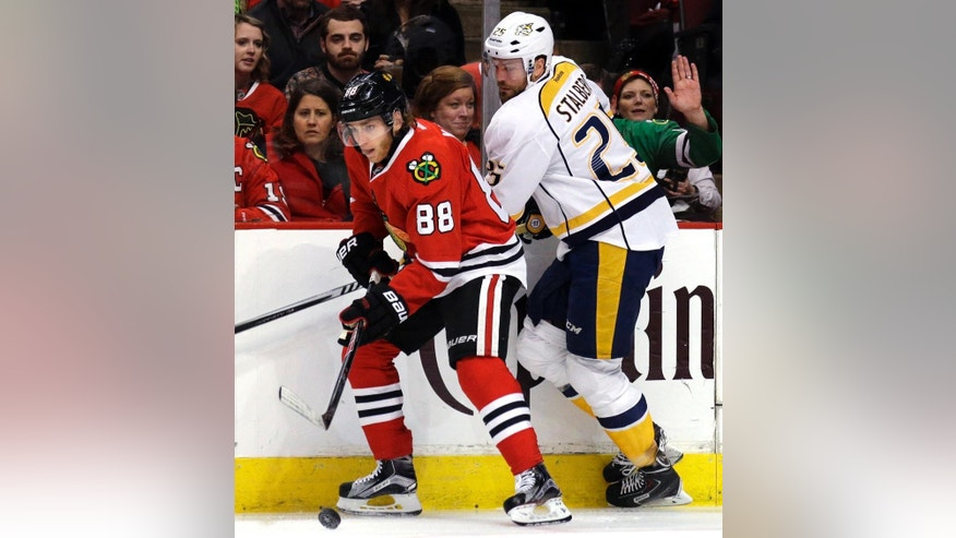 Chicago Blackhawks right wing Patrick Kane, left, controls the puck against Nashville Predators left wing Viktor Stalberg during the first period in Game 6 of an NHL Western Conference hockey playoff series Saturday, April 25, 2015, in Chicago. (AP Photo/Nam Y. Huh)