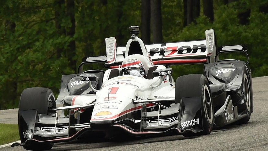 Driver Will Power (1) races during practice at the IndyCar Indy Grand Prix of Alabama auto race at Barber Motorsports Park, Saturday, April 25, 2015, in Birmingham, Ala. (Joe Songer/AL.com via AP) MAGS OUT; MANDATORY CREDIT