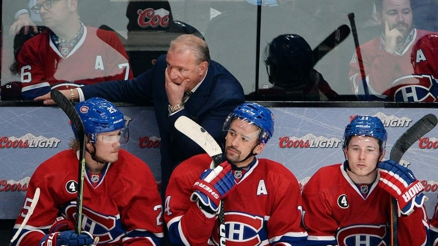 Montreal Canadiens coach Michel Therrien and players Jacob De La Rose, left, Tomas Plekanec, center, and Brendan Gallagher watch the final seconds of the team's 5-1 loss to the Ottawa Senators in Game 5 of a first-round NHL hockey playoff series, Friday, April 24, 2015, in Montreal. (Ryan Remiorz/The Canadian Press via AP)