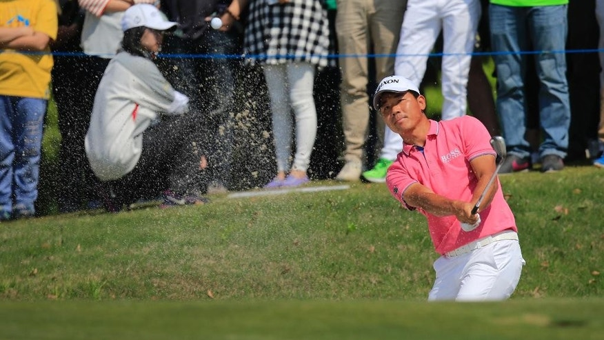 Wu Ashun of China hits from a bunker on the 8th hole during the final round of the Volvo China Open in Shanghai, China, Sunday, April 26, 2015. (AP Photo)