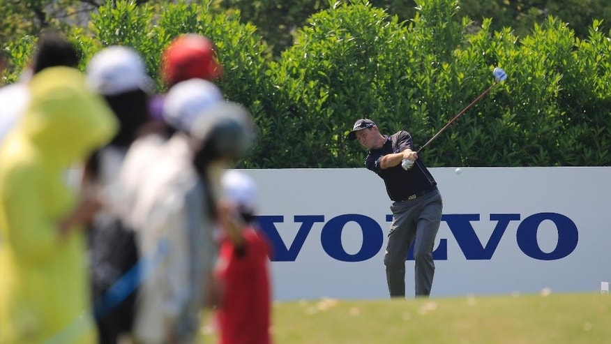 David Howell of England tees off on the 7th hole during the final round of the Volvo China Open in Shanghai, China, Sunday, April 26, 2015. (AP Photo)