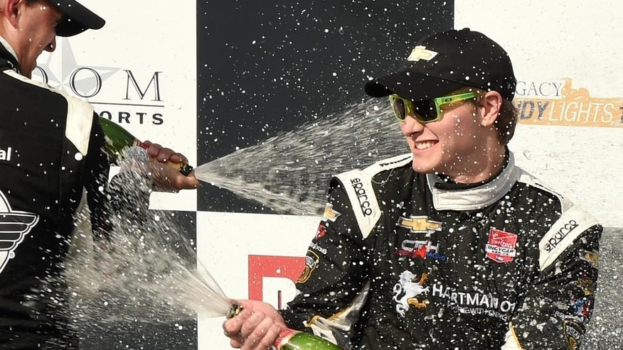 Josef Newgarden (67), right, celebrates after winning the Indy Grand Prix of Alabama at Barber Motorsports Park, Sunday, April 26, 2015, in Birmingham, Ala. Newgarden held off a hard-charging Graham Rahal on Sunday in the Indy Grand Prix of Alabama for his first IndyCar Series victory. (Joe Songer/AL.com via AP) MAGS OUT; MANDATORY CREDIT