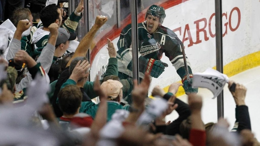 Minnesota Wild left wing Zach Parise reacts in front of the fans after scoring on St. Louis Blues goalie Brian Elliott during the third period of Game 6 of an NHL hockey first-round playoff series in St. Paul, Minn., Sunday, April 26, 2015. The Wild won 4-1 to win the series and advance to the second round. (AP Photo/Ann Heisenfelt)