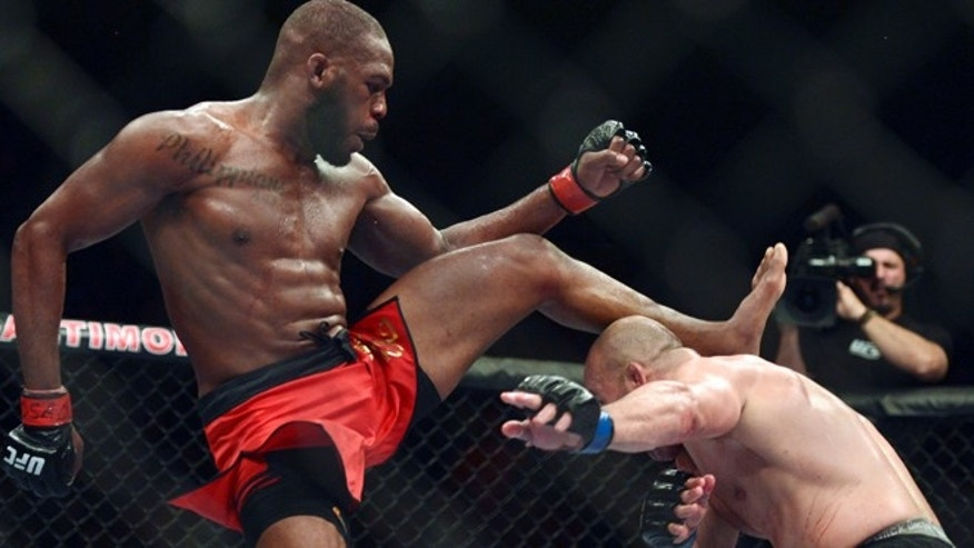 April 26, 2014:  Glover Teixeira ducks under a kick from Jon Jones during the UFC light heavy weight championship fight at  Baltimore Arena in Baltimore, Md.