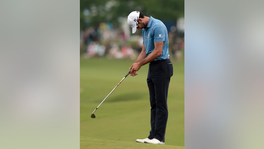 Cameron Tringale reacts after missing a chip on the 18th hole during the final round of the Zurich Classic PGA golf tournament, Sunday, April 26, 2015, in Avondale, La. (AP Photo/Butch Dill)
