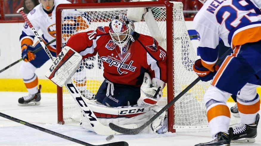 Washington Capitals goalie Braden Holtby (70) blocks a shot by New York Islanders center Brock Nelson (29) during the second period of Game 7 in the first round of the NHL hockey Stanley Cup playoffs, Monday, April 27, 2015, in Washington. (AP Photo/Alex Brandon)