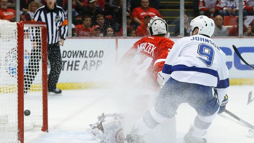 Tampa Bay Lightning center Tyler Johnson (9) scores on Detroit Red Wings goalie Petr Mrazek (34) in the first period of Game 6 of a first-round NHL Stanley Cup hockey playoff series in Detroit Monday, April 27, 2015. (AP Photo/Paul Sancya)