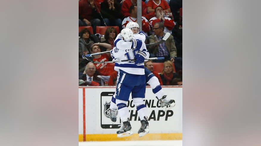 Tampa Bay Lightning center Tyler Johnson, facing, celebrates his goal against the Detroit Red Wings with Ondrej Palat in the second period of Game 6 of a first-round NHL Stanley Cup hockey playoff series, Monday, April 27, 2015, in Detroit. (AP Photo/Paul Sancya)