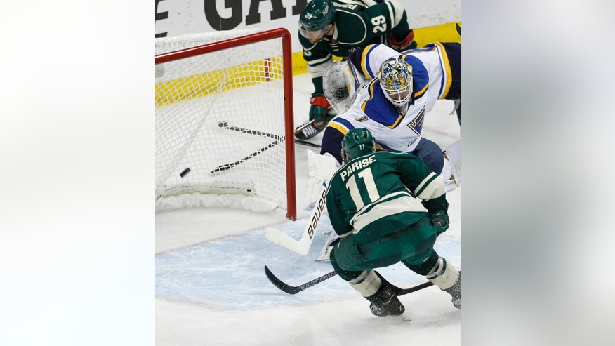 Minnesota Wild left wing Zach Parise (11) scores on St. Louis Blues goalie Brian Elliott (1) during the third period of Game 6 of an NHL hockey first-round playoff series in St. Paul, Minn., Sunday, April 26, 2015. The Wild won 4-1 to win the series and advance to the second round. (AP Photo/Ann Heisenfelt)